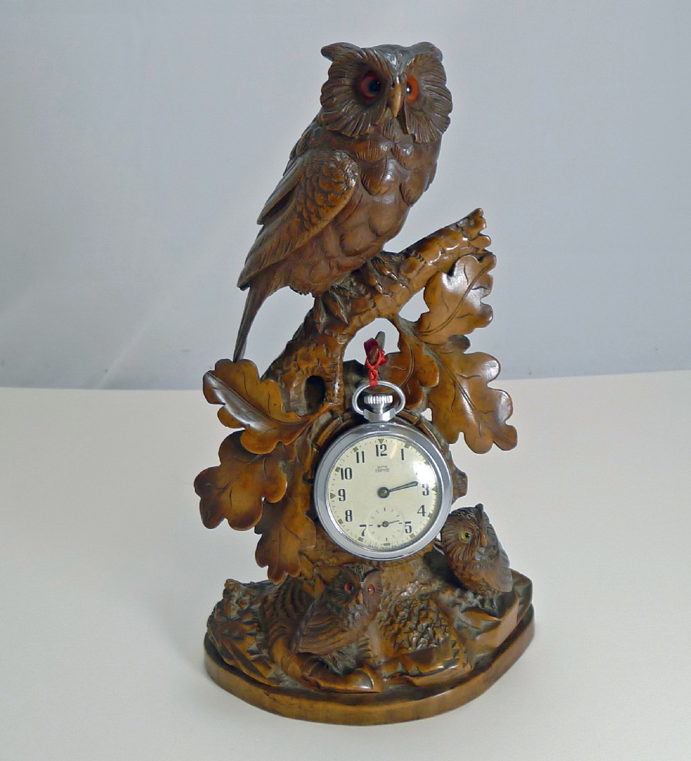 magnificent figural black forest pocket watch stand owl family c1900