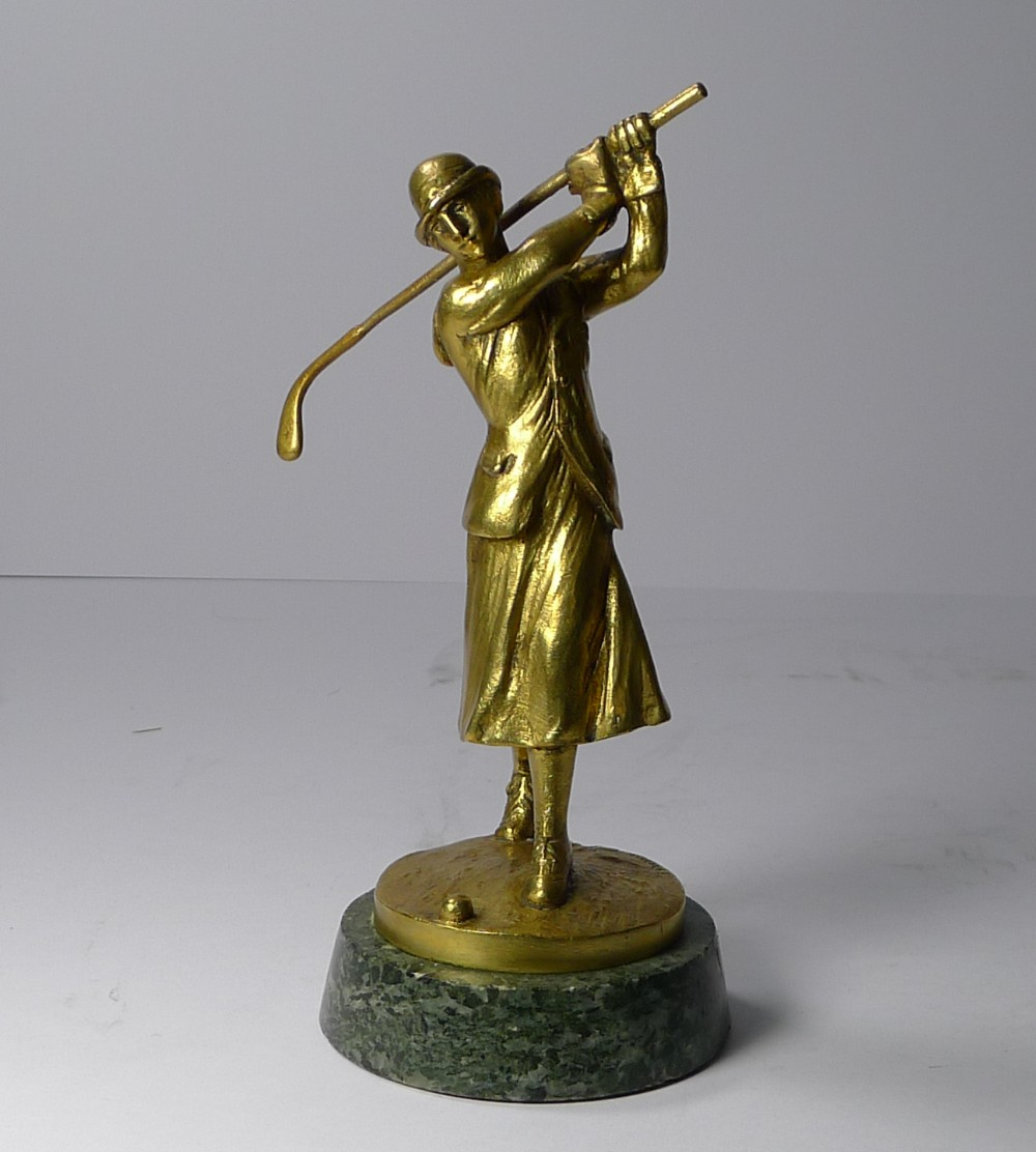 an art deco bronze car mascot in the from of a lady golfer jose dunach